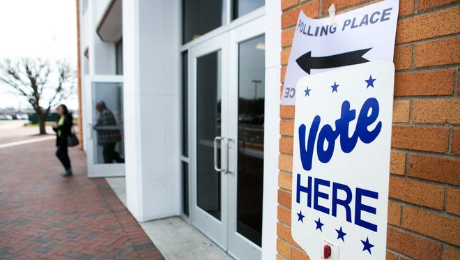 Voters leave the William Penn High polling place after voting on the Colonial School District Referendum Tuesday.