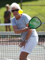 Marie Killeen from Pearl River smashes a return during
