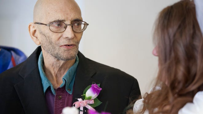 Daniel Robertson recites his vows to Leeanna during their wedding ceremony Wednesday at the Blue Water Hospice Home in Marysville.