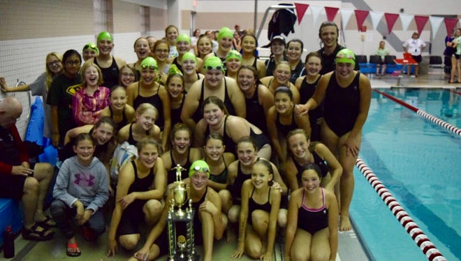 Members of the D.C. Everest sixth-, seventh- and eighth-grade girls swim team pose with their trophy after their conference win Oct. 7 in Wausau.