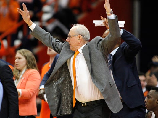 Syracuse head coach Jim Boeheim jumps on the sidelines late in the second half of an NCAA college basketball game against North Carolina in Syracuse, N.Y., Wednesday, Feb. 21, 2018. North Carolina won 78-74. (AP Photo/Nick Lisi)