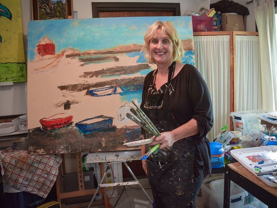 Working artist Denise Justice in her studio at the