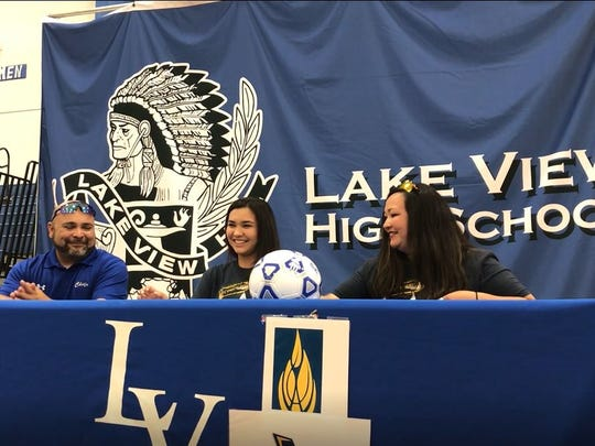 Lake View High School's Veronica Prieto, center, signs an agreement to play soccer for Wayland Baptist University on Wednesday, May 16, 2018, at Lake View High School.