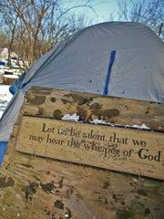 """Tents sit in the snow at the homeless encampment referred to as """"The Jungle,"""" Thursday, February 9, 2017.  Residents at the camp say they've been told that they must leave the area soon."""