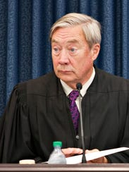 U.S. District Court Judge William Sessions III sits