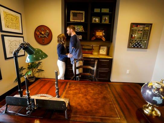 Retired U.S. Navy sailor Taylor Morris and his wife,