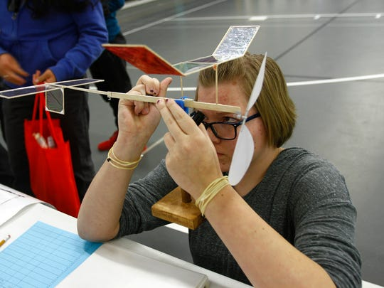 Farmington High School student Kasadi Dixon puts the finishing touches on her entry Saturday before taking part in the Wright Stuff competition during the 2016 Northwest Regional Science Olympiad at Mesa View Middle School in Farmington.