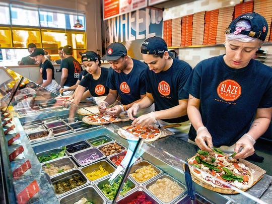 The assembly line format at Blaze Pizza.