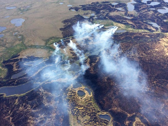 Smoke rises from a wildfire in the Yukon Delta National
