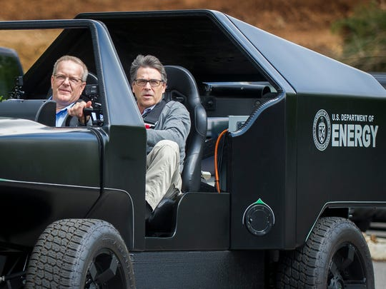Secretary of Department of Energy Rick Perry test drives a 3D-printed vehicle during a tour of Oak Ridge National Laboratory's Manufacturing Demonstration Facility on Monday, May 22, 2017.