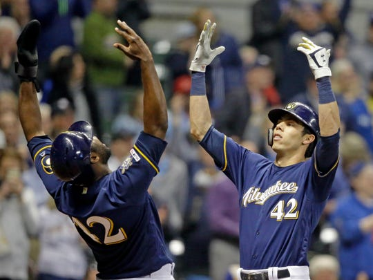 Milwaukee Brewers' Christian Yelich, right, reacts
