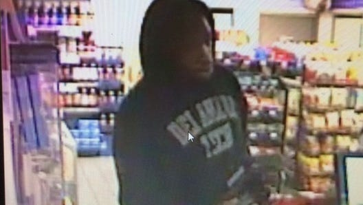 Surveillance footage of the Laurel gas station robbery suspect.