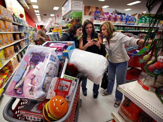 Target shoppers Kelly Foley, left, Debbie Winslow,