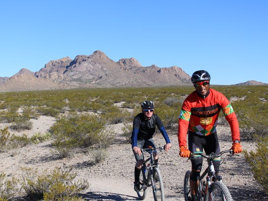 Two mountain bikers on a trail in the Doña Ana Mountains,
