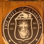 City council chambers has the city seal that includes a cross during a special Pensacola City Council meeting to discuss its invocation procedures on Thursday, July 7, 2016.  David Suhor, a representative of The Satanic Temple West Florida, is scheduled to deliver the invocation at the council's July 14 meeting.