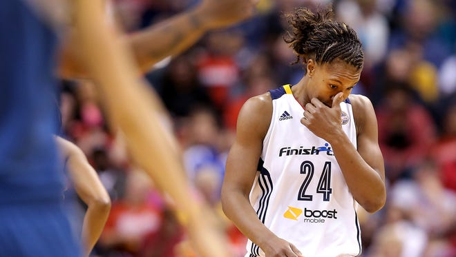 A dejected Indiana Fever Tamika Catchings (24) late in the second half of their game. The Indiana Fever play the Minnesota Lynx in Game #3 of the WNBA Finals Friday, October 9, 2015, evening at Bankers Life Fieldhouse.