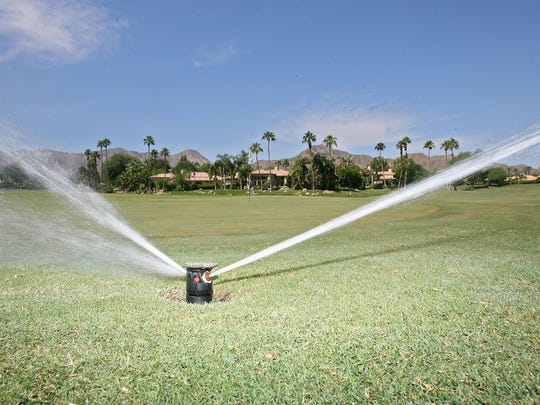 A sprinkler waters the grass at Rancho La Quinta Country Club on Sept. 12, 2013.