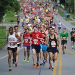 John Frieberger, 44, of East Rochester runs the Firecracker Five Mile in Fairport, which was the race distance in 2013.