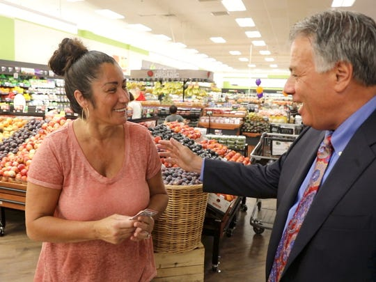 Larry Inserra talking with customer Teresa Circelli