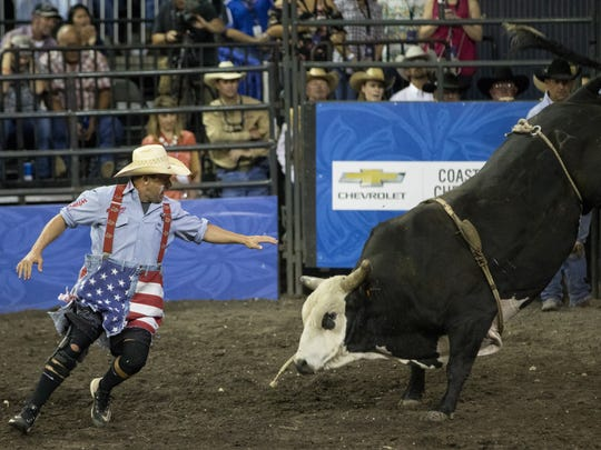 Bullfighter Blue Jeanes distracts a bull after the rider was thrown off during the first night of the Buc Days Corpus Christi Rodeo at the American Bank Center on Thursday, April 28, 2017.