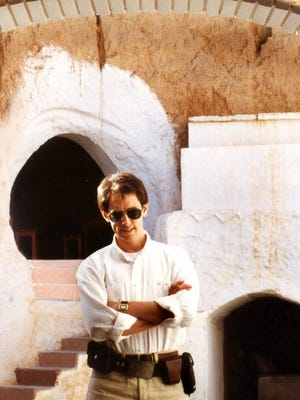 "David West Reynolds in front of the Hotel Sidi Driss in Matmata, the only ""Star Wars"" shooting location he knew when he set out in Tunisia. Reynolds said the set decorations like the ceiling mural an the doorway frame are still in place as the crew left them."