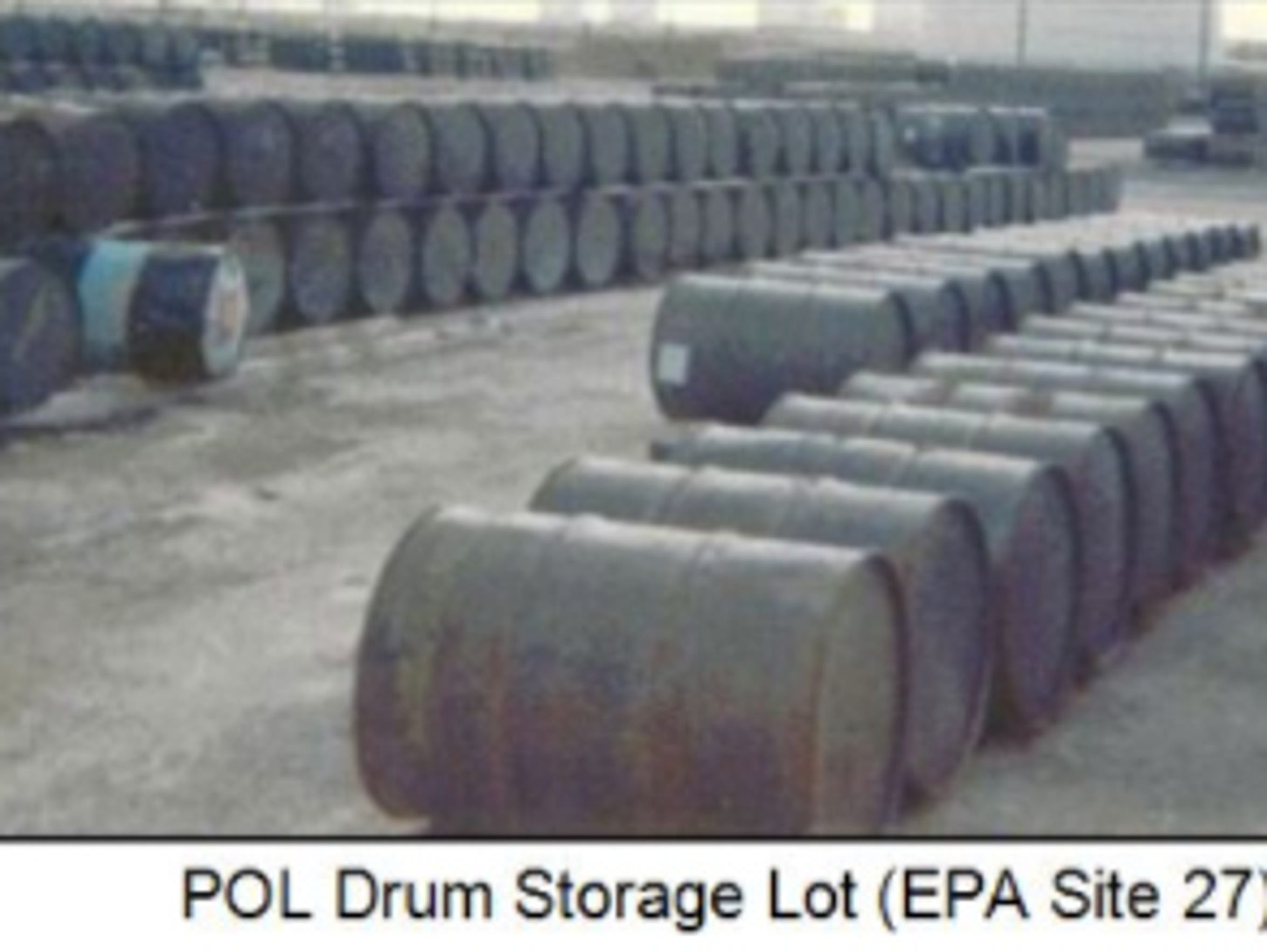 A photo of a drum storage lot at Andersen Air Force