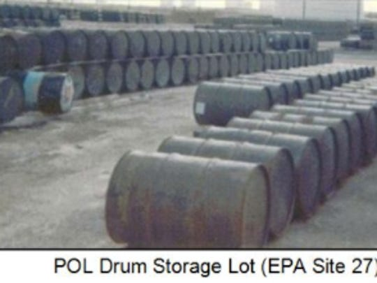This photo shows a drum storage lot at Andersen Air Force Base in the Vietnam War era, which was later designated an EPA cleanup site.