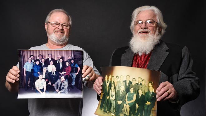 Jerry Clement, left, and Ralph Clement hold photographs of their family Friday, Dec. 16, during an interview in St. Cloud. The Clements are two of 14 siblings in the family. They will gather Dec. 23 with all of their siblings to celebrate a combined 1,000 years of life.