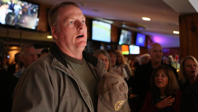 Leon Woods of Brick, a 22-year veteran of the US Army, sings the National Anthem. Woody's Tavern in Farmingdale didn't show football on Sunday in respect for veterans on Veterans Day weekend. In place of the games, the bar will hold a special concert featuring members of the New Jersey-based country group After the Reign, with a portion of the proceeds going to the Green Beret Foundation through Special Forces Association Chapter 19. Farmingdale, New Jersey. Sunday, November 12, 2017.