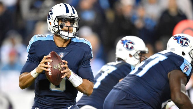 Titans quarterback Marcus Mariota (8) drops back to pass during the second half at Nissan Stadium Monday, Oct. 16, 2017 in Nashville, Tenn.