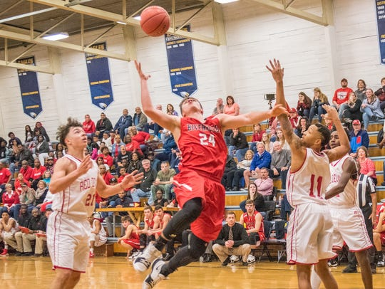 Riverheads' Grant Painter puts a shot up in the lane