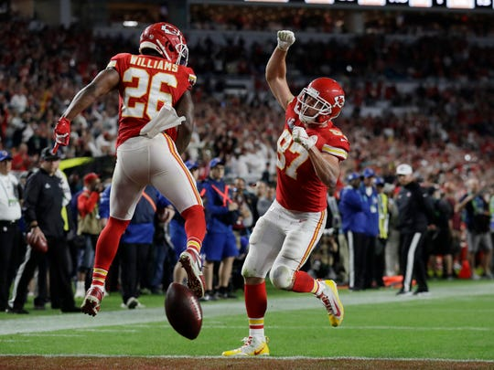 Kansas City Chiefs' Travis Kelce (87) celebrates his touchdown with Kansas City Chiefs' Damien Williams during the second half of the NFL Super Bowl 54 football game against the San Francisco 49ers, Sunday, Feb. 2, 2020, in Miami Gardens, Fla. (AP Photo/Lynne Sladky)
