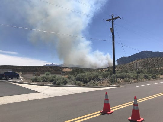 A view of the James Fire from the north closure of Jacks Valley Road on Monday, July 9, 2018.