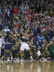 Notre Dame's Arike Ogunbowale (24) puts up a last-second
