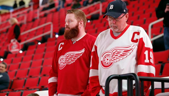 Detroit Red Wings fans look out over the ice following the cancellation of the Red Wings game with the Carolina Hurricanes due to a problem with the ice in the PNC Arena Monday.