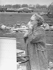 Mrs. Clifford Davis reacts to seeing the ruins of the house owned by her daughter and son-in-law, Phillip Amon of Marion on Monday, April 12, 1965. The couple survived the Palm Sunday tornadoes of April 11, 1965, which killed 140 people in northern and central Indiana.