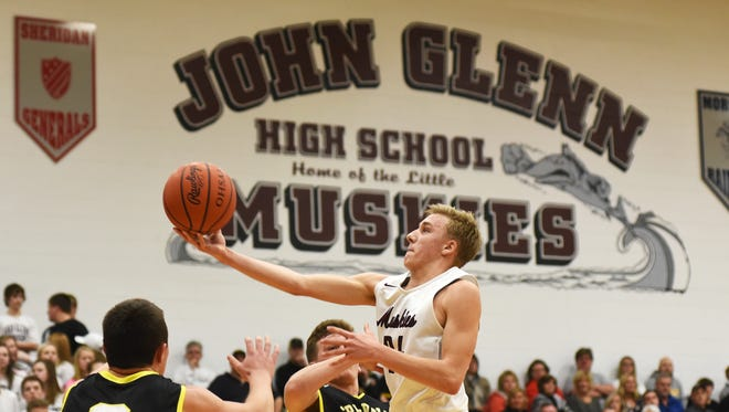 John Glenn's Justin Heacock puts up a shot against Tri-Valley Friday night in New Concord.