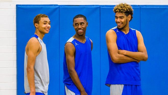 Shadow Mountain High School boys basketball players Jaelen House, Jovan Blacksher, Jr., and Darion Spottsville wait their turn at practice, Thursday, November 10, 2016.