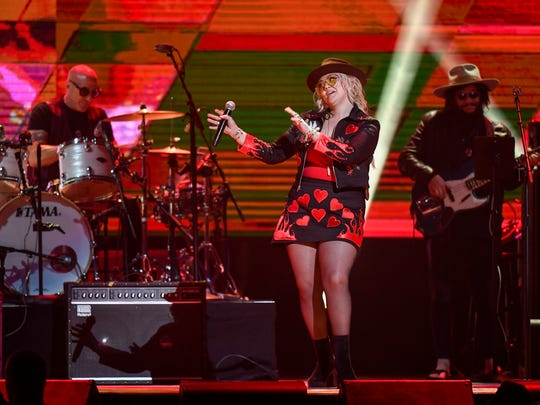 Performer Elle King sings to Kenny Rogers at the All
