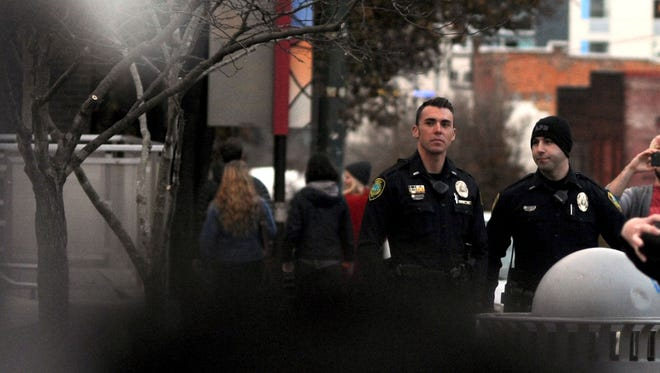 Asheville police watch as about 200 protestors gather in downtown Asheville on Nov. 25 in response to the grand jury's decision not to indict the white police officer in the shooting death of 18-year-old Michael Brown in Ferguson, Missouri.