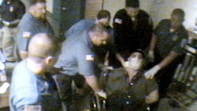 Amit Bornstein surrounded by officers