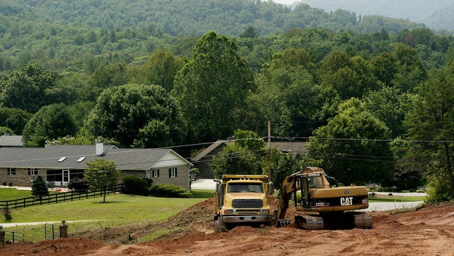 Citizen-Times file photo Grading started recently on Sovereign Oaks, a 99-home development on the former Coggins Farm site in eastern Buncombe County.