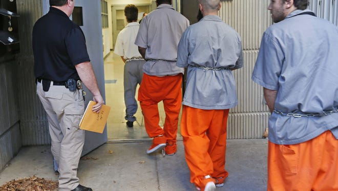 Inmates are transported into the Greene County Jail. Springfield City Council approved contracts Monday to transport its municipal inmates to Miller and Taney counties.