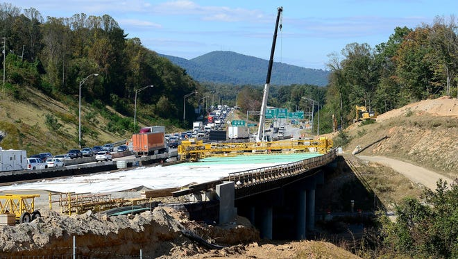 """The Pond Road bridge replacement work, shown here in March, is nearing completion. It was not designed to ease traffic congestion at """"Dysfunction Junction,"""" but other help is coming."""
