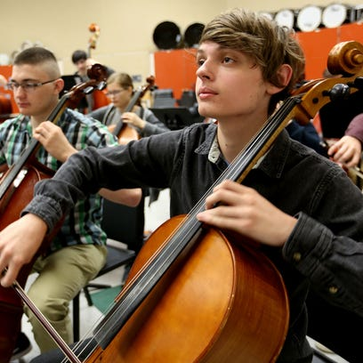 Trevor Fisher, a senior, plays first-chair cello in