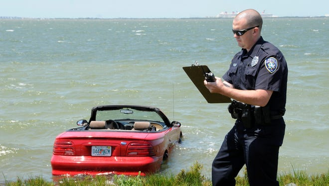 A Ford Mustang went into the river on the north shore of the Cocoa Beach Causeway, west of Cape Canaveral Hospital on State Road 520.