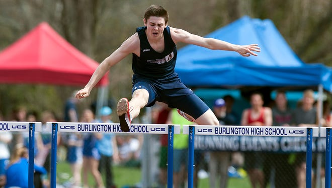 Mount Mansfield's Alec Eschholz leaps over the hurdles during the 300m hurdles event during the 42nd annual Burlington Invitational track and field meet at Burlington High School on Saturday May 10, 2014 in Burlington, Vermont.