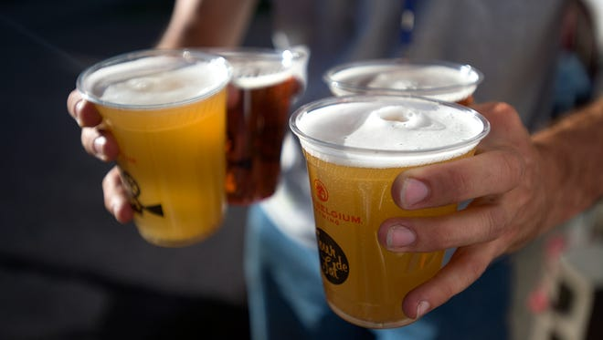 Cups of New Belgium beer are pictured here. To the south of Fort Collins, Denver-based brewery Alpine Dog has a unique tactic for serving beer.
