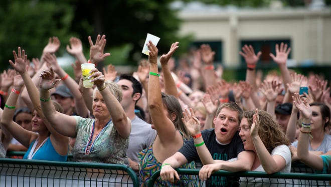 People sings along with American Authors as they play on the last day of the Taste of Fort Collins festival Sunday, June 15 2014.