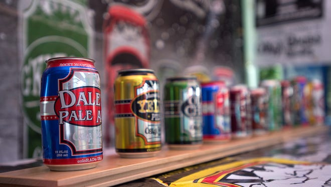 Oskar Blues' canned beers are lined up at the 25th annual Colorado Brewers' Festival in Fort Collins Saturday, June 28, 2014.